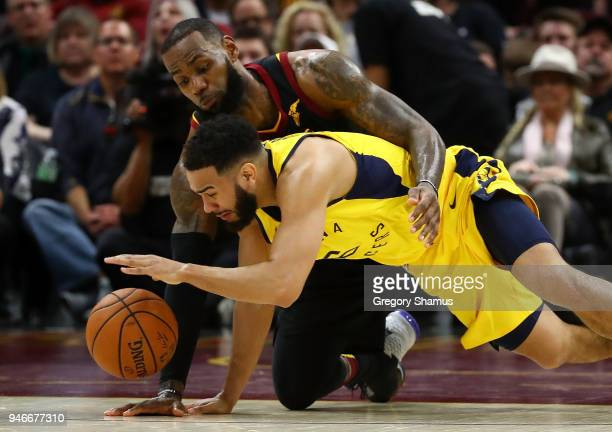 Cory Joseph of the Indiana Pacers dives for the ball in front of LeBron James of the Cleveland Cavaliers during the second half Game One of the...