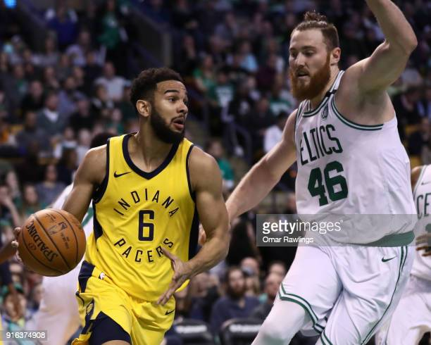 Cory Joseph of the Indiana Pacers drives to the basket on Aron Baynes of the Boston Celtics during the first quarter of the game at TD Garden on...