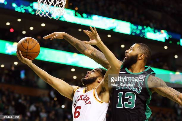 Cory Joseph of the Indiana Pacers goes for a layup while guarded by Marcus Morris of the Boston Celtics during a game at TD Garden on March 11 2018...