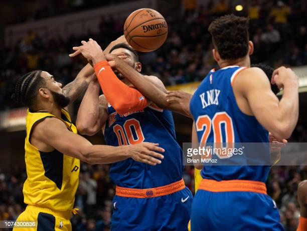 Cory Joseph of the Indiana Pacers left attempts to get the ball from Enes Kanter of the New York Knicks during the second half of the game at Bankers...
