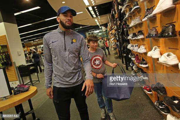 Cory Joseph of the Indiana Pacers particiaptes in the 'Shop with the Pacers' christmas event at Circle Center Mall on December 3 2017 in Indianapolis...