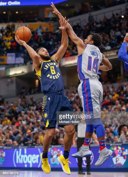 Cory Joseph of the Indiana Pacers shoots the ball against Ish Smith of the Detroit Pistons at Bankers Life Fieldhouse on December 15 2017 in...