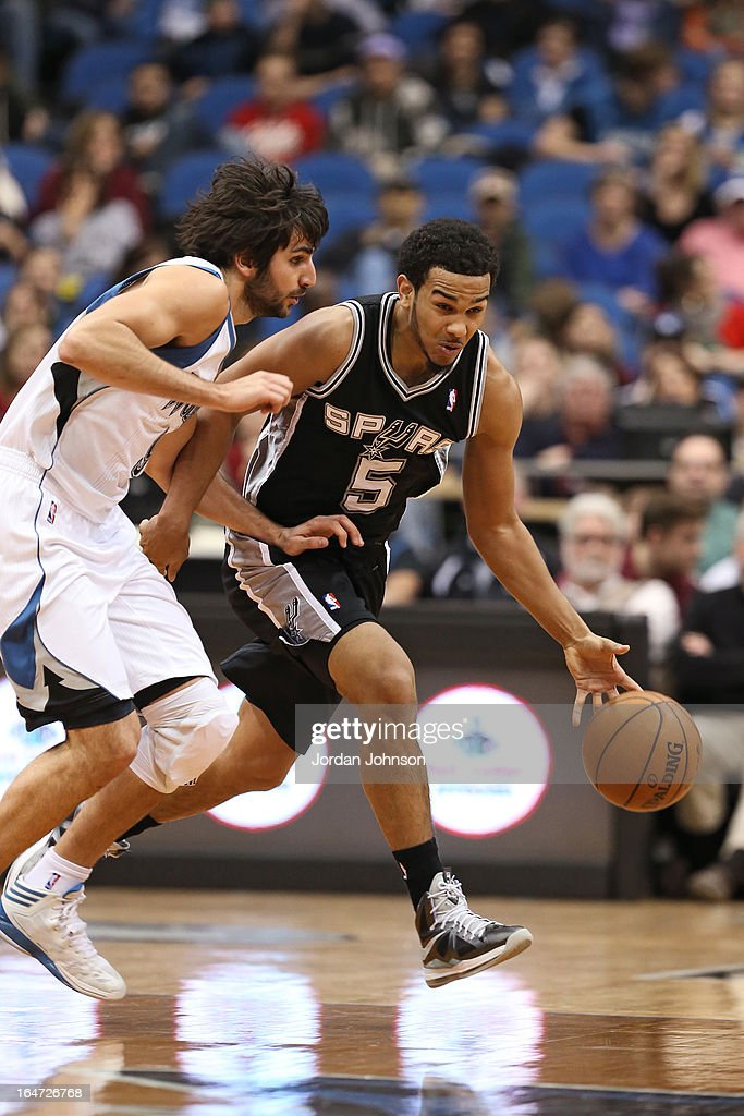 Cory Joseph #5 of the San Antonio Spurs brings the ball up court against the Minnesota Timberwolves on March 12, 2013 at Target Center in Minneapolis, Minnesota.