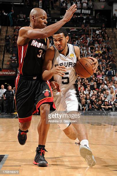Cory Joseph of the San Antonio Spurs drives to the basket against Ray Allen of the Miami Heat during Game Four of the 2013 NBA Finals on June 13 2013...