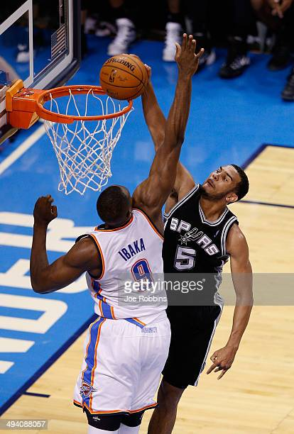 Cory Joseph of the San Antonio Spurs dunks on Serge Ibaka of the Oklahoma City Thunder in the second half during Game Four of the Western Conference...