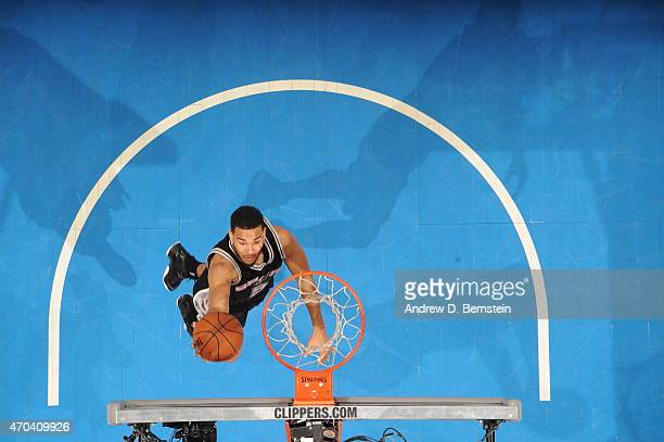 Cory Joseph of the San Antonio Spurs goes to the basket against the Los Angeles Clippers in Game One of the Western Conference Quarterfinals during...