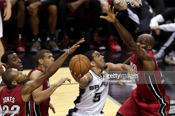 Cory Joseph of the San Antonio Spurs goes up for a shot against Joel Anthony of the Miami Heat in the fourth quarter during Game Three of the 2013...