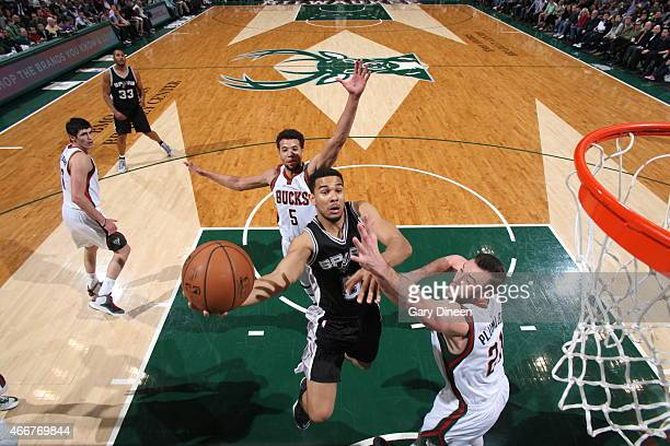 Cory Joseph of the San Antonio Spurs goes up for a shot against the Milwaukee Bucks on March 18 2015 at BMO Harris Bradley Center in Milwaukee...