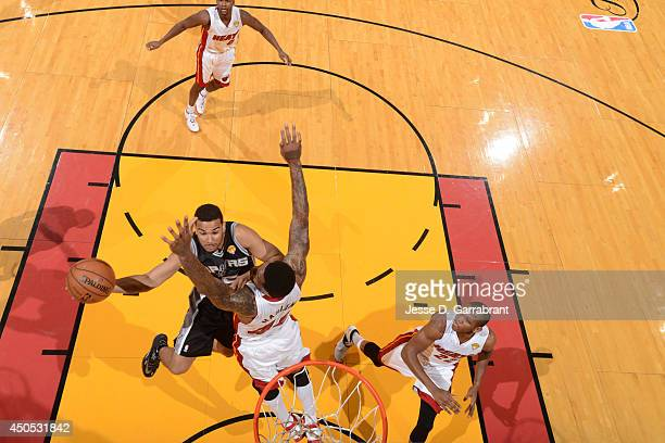 Cory Joseph of the San Antonio Spurs goes up for the layup against the Miami Heat during Game Six of the 2014 NBA Finals on June 12 2014 at American...