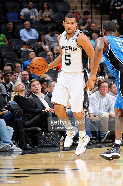 Cory Joseph of the San Antonio Spurs handles the ball against Orlando Magic during the first preseason game at the ATT Center on October 22 2013 in...