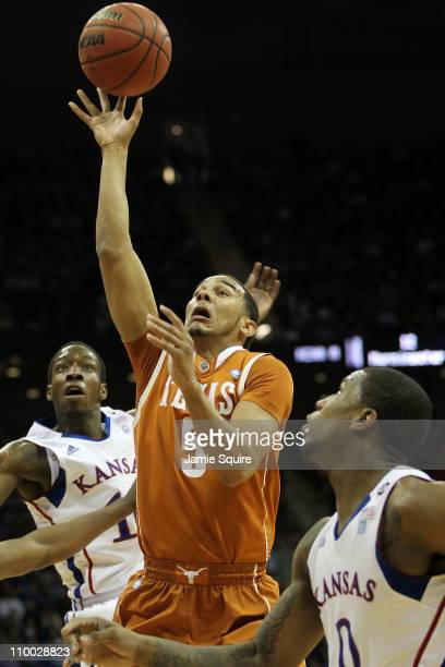 Cory Joseph of the Texas Longhorns goes up for a shot against the Kansas Jayhawks in the first half of the 2011 Phillips 66 Big 12 Men's Basketball...