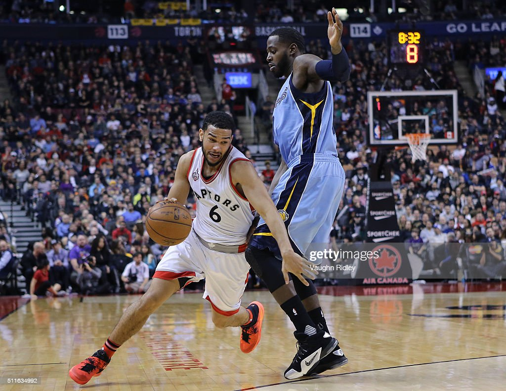 Cory Joseph #6 of the Toronto Raptors dribbles past JaMychal Green #0 of the Memphis Grizzlies during the second half of an NBA game at the Air Canada Centre on February 21, 2016 in Toronto, Ontario, Canada.