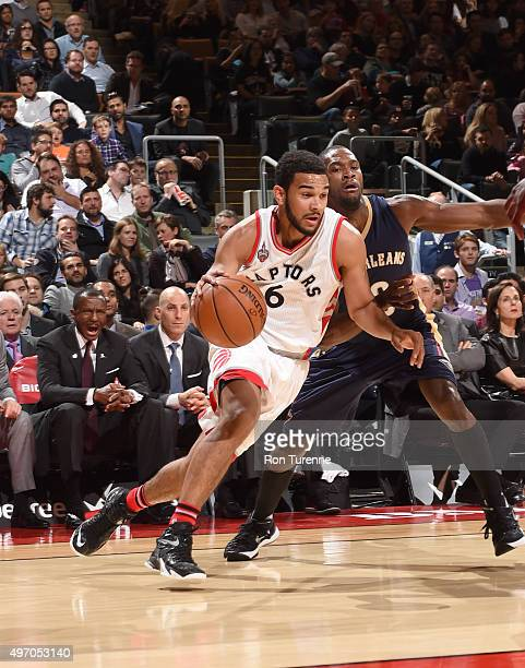 Cory Joseph of the Toronto Raptors dribbles the ball against the New Orleans Pelicans on November 13 2015 at the Air Canada Centre in Toronto Ontario...