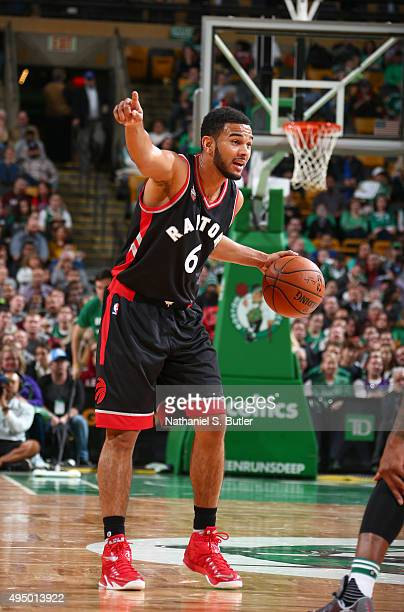 Cory Joseph of the Toronto Raptors dribbles the ball and calls out to his teammates during a game against the Boston Celtics on October 30 2015 at TD...