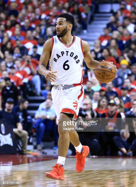 Cory Joseph of the Toronto Raptors dribbles the ball in the first half of Game Five of the Eastern Conference Quarterfinals against the Milwaukee...