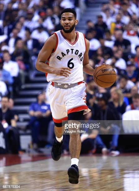 Cory Joseph of the Toronto Raptors dribbles the ball in the first half of Game Three of the Eastern Conference Semifinals against the Cleveland...