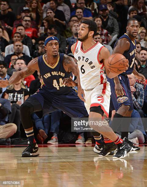 Cory Joseph of the Toronto Raptors drives to the basket against Dante Cunningham of the New Orleans Pelicans on November 13 2015 at the Air Canada...