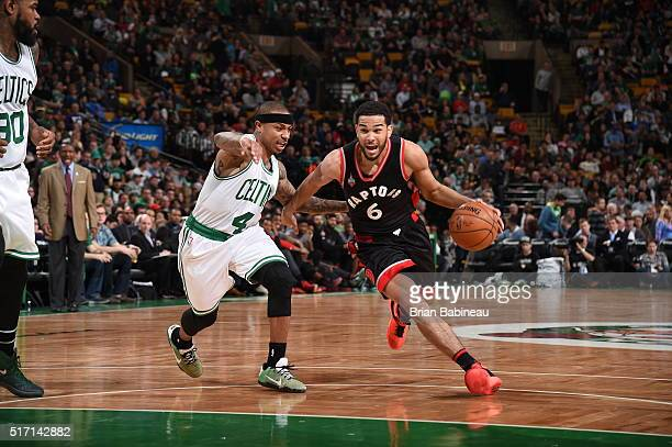 Cory Joseph of the Toronto Raptors drives to the basket against Isaiah Thomas of the Boston Celtics on March 23 2016 at the TD Garden in Boston...