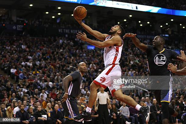 Cory Joseph of the Toronto Raptors drives to the basket against the Golden State Warriors on December 5 2015 at Air Canada Centre in Toronto Ontario...