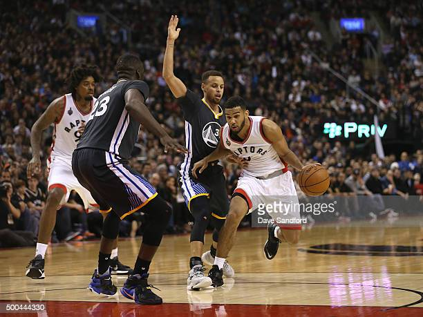 Cory Joseph of the Toronto Raptors handles the ball against Stephen Curry of the Golden State Warriors on December 5 2015 at Air Canada Centre in...