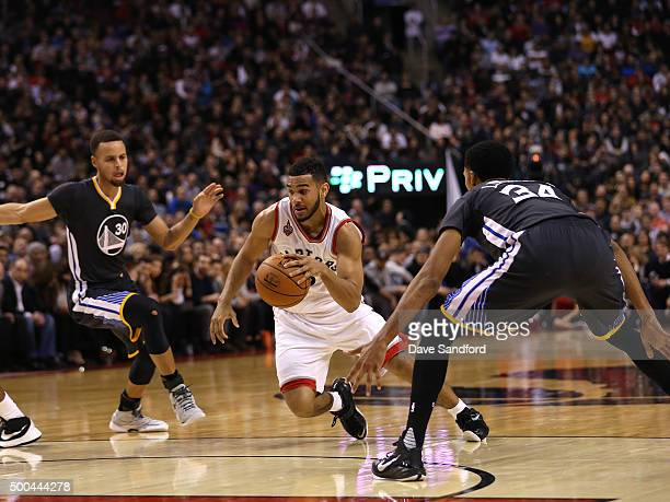 Cory Joseph of the Toronto Raptors handles the ball against the Golden State Warriors on December 5 2015 at Air Canada Centre in Toronto Ontario...