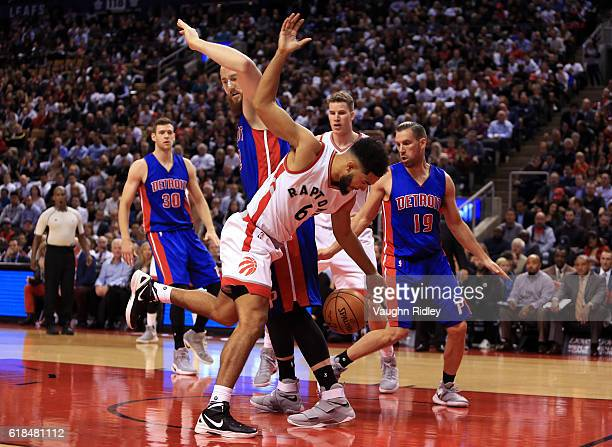 Cory Joseph of the Toronto Raptors loses the ball as Aron Baynes of the Detroit Pistons defends during the second half of an NBA game at Air Canada...