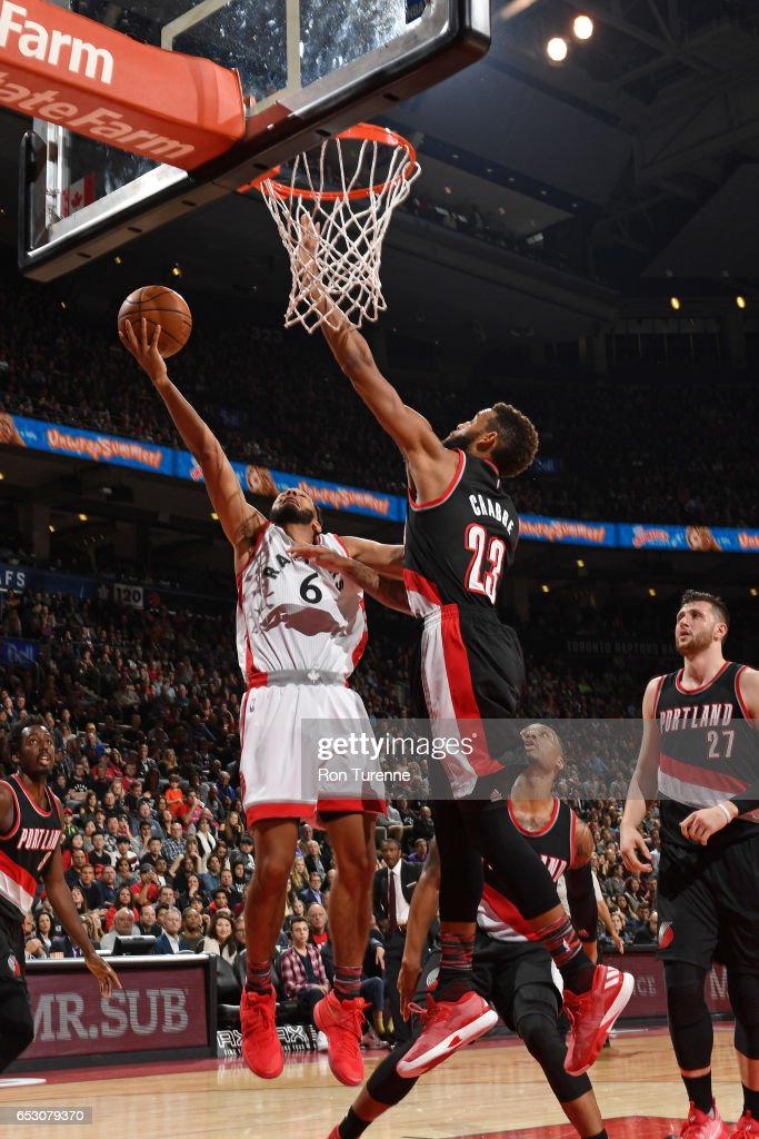 Cory Joseph #6 of the Toronto Raptors shoots a lay up against the Portland Trail Blazers on February 26, 2017 at the Air Canada Centre in Toronto, Ontario, Canada.