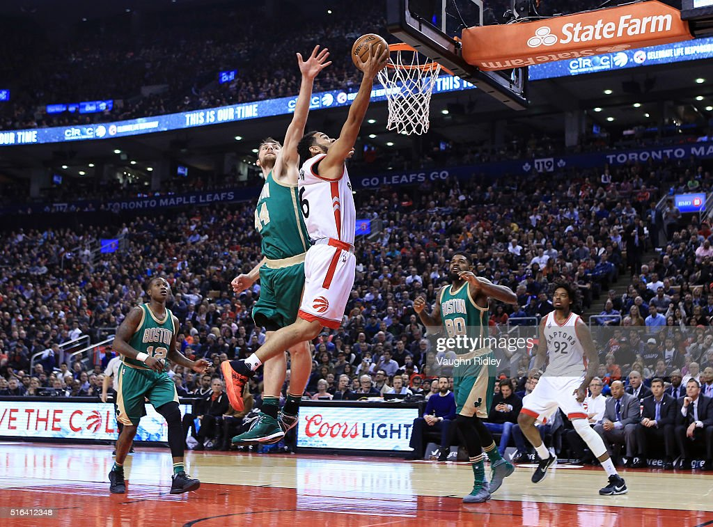 Cory Joseph #6 of the Toronto Raptors shoots the ball as Tyler Zeller #44 of the Boston Celtics defends during the first half of an NBA game at the Air Canada Centre on March 18, 2016 in Toronto, Ontario, Canada.