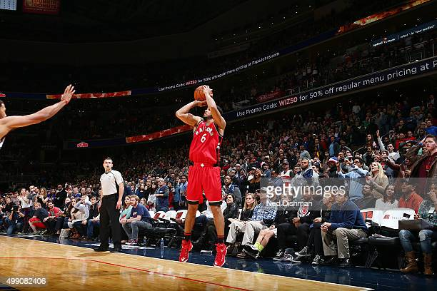 Cory Joseph of the Toronto Raptors takes the game winning shot against the Washington Wizards on November 28 2015 at Verizon Center in Washington DC...