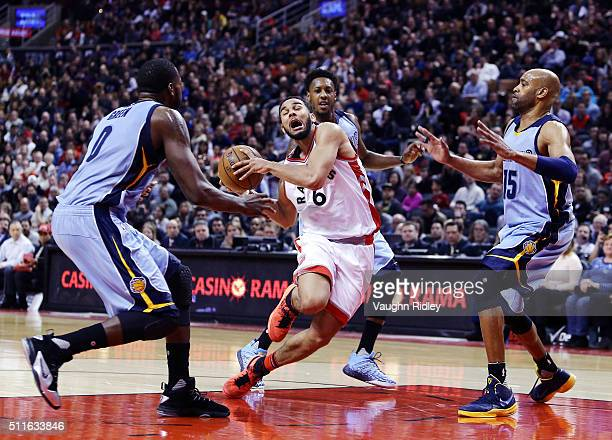 Cory Joseph of the Toronto Raptors trips as he dribbles the ball during the second half of an NBA game against the Memphis Grizzlies at the Air...