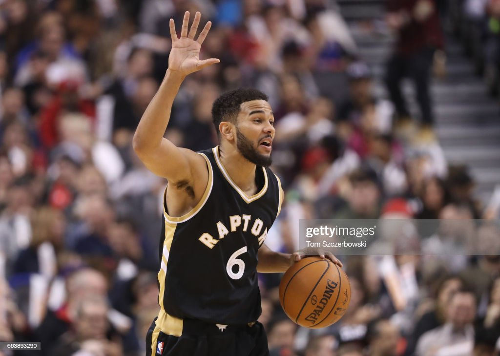 Cory Joseph #6 of the Toronto Raptors yells out instructions as he advances the ball up the court against the Philadelphia 76ers during NBA game action at Air Canada Centre on April 2, 2017 in Toronto, Canada.