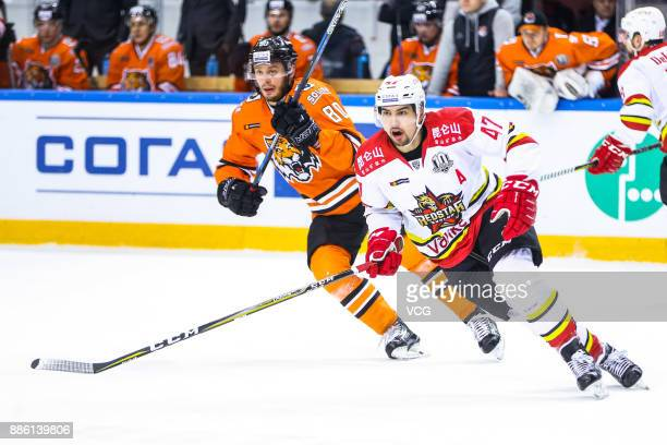 Cory Kane of HC Kunlun Red Star and Tomas Zohorna of Amur Khabarovsk in action during the 2017/18 Kontinental Hockey League KHL Regular Season match...