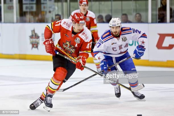 Cory Kane of HC Kunlun Red Star and Vyacheslav Voynov of SKA Saint Petersburg vie for the puck during the 2017/18 Kontinental Hockey League Regular...
