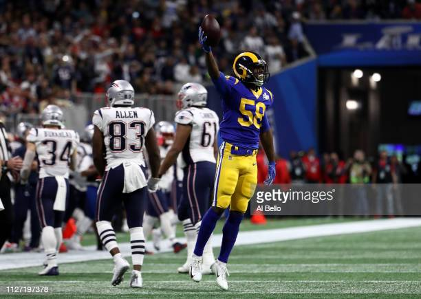 Cory Littleton of the Los Angeles Rams celebrates his first quarter interception against the New England Patriots during Super Bowl LIII at...