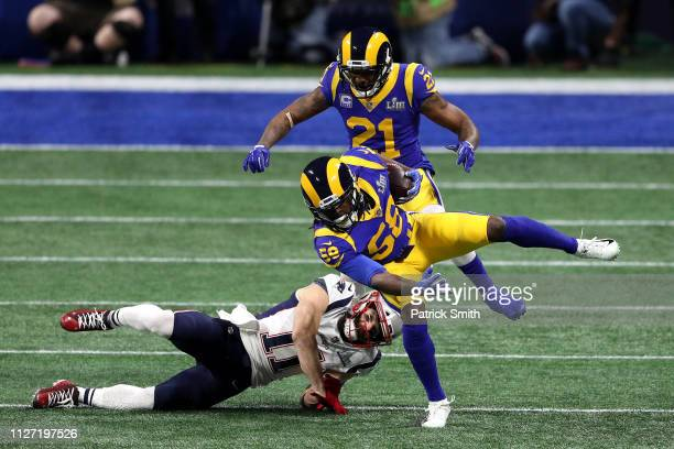 Cory Littleton of the Los Angeles Rams intercepts the ball in the first quarter on a pass intended for Julian Edelman of the New England Patriots...