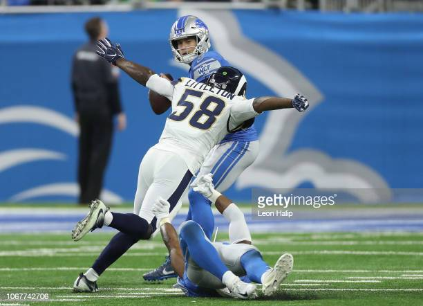 Cory Littleton of the Los Angeles Rams sacks Matthew Stafford of the Detroit Lions during the fourth quarter of the game at Ford Field on December 2...