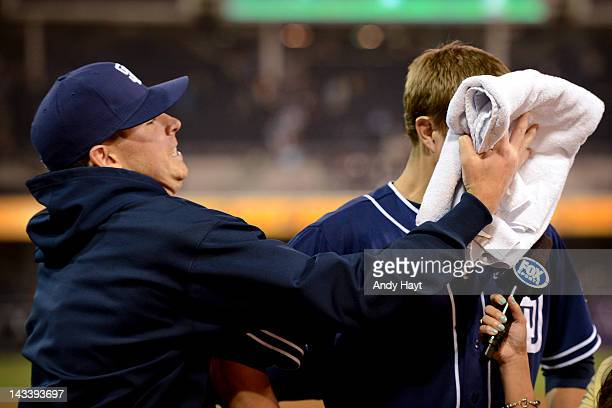 Cory Luebke of the San Diego Padres is hit by a shaving cream pie by teammate Tim Stauffer after the game against the Philadelphia Phillies at Petco...