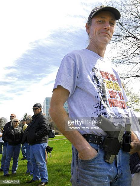 Cory Mills of Biddeford attends an opencarry gathering at Back Cove in Portland to publicize the right to carry unconcealed weapons He is carrying a...