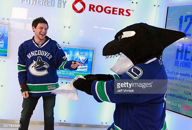 Cory Monteith a Canadian actor from the television show 'Glee' jokes around with Vancouver Canucks mascot Fin before their game against the Edmonton...
