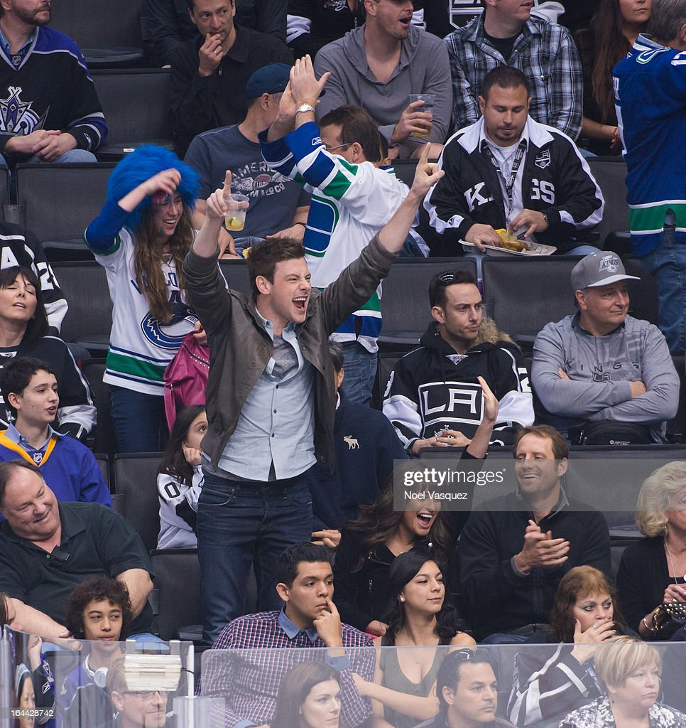 Cory Monteith (L) and Lea Michele attend a hockey game between the Vancouver Canucks and the Los Angeles Kings at Staples Center on March 23, 2013 in Los Angeles, California.