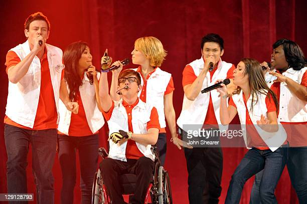 Cory Monteith, Kevin McHale, Dianna Agron, Harry Shum Jr., Lea Michele, and Amber Riley perform on the Glee! concert tour at Honda Center on May 27,...