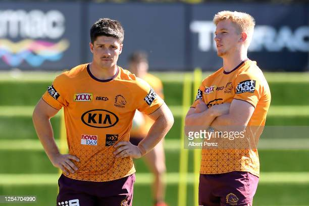 Cory Paix speaks to Tom Dearden during a Brisbane Broncos NRL training session at the Clive Berghofer Centre on July 07 2020 in Brisbane Australia