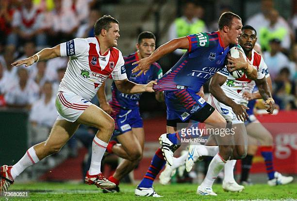 Cory Paterson of the Knights makes a line break as Josh Morris attempts to tackle during the round two NRL match between the St George Illawarra...