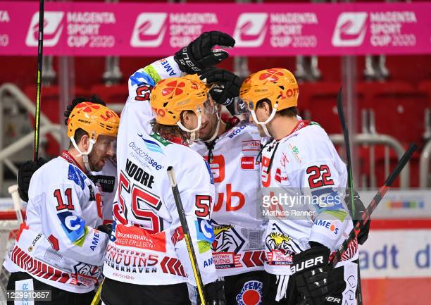 Cory Quirk, Mike Moore, Tomas Sykora and Vladimir Eminger of the Fischtown Pinguins celebrate after scoring the 0:2 during the game between the...