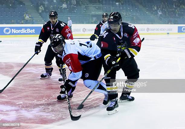 Cory Quirk of Sonderjyske Vojens in action against Norman Hauner 94 of Krefeld Pinguine during the Champions Hockey League group stage game between...