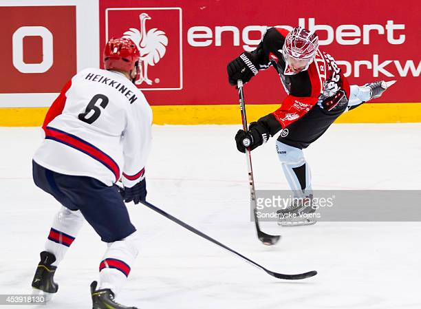 Cory Quirk of Sonderjyske Vojens looks to shoot the puck past Eemeli Heikkinen of IFK Helsinki during the Champions Hockey League group stage game...