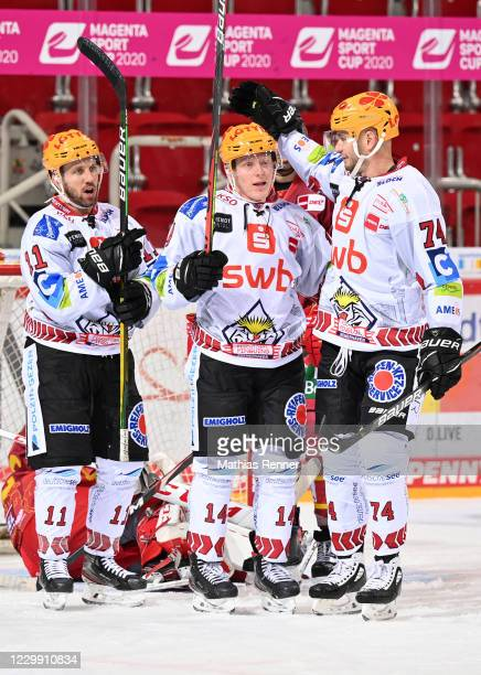 Cory Quirk, Ross Mauermann and Tomas Sykora of the Fischtown Pinguins celebrate after scoring the 0:2 during the game between the Duesseldorfer EG...