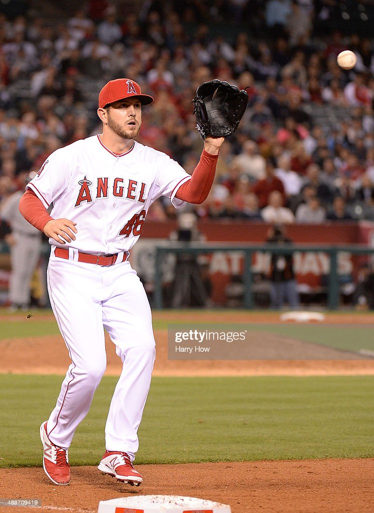 Cory Rasmus #46 of the Los Angeles Angels makes a catch at first for an out of Mark Teixeira #25 of the New York Yankees to end the eighth inning at Angel Stadium of Anaheim on May 7, 2014 in Anaheim, California.