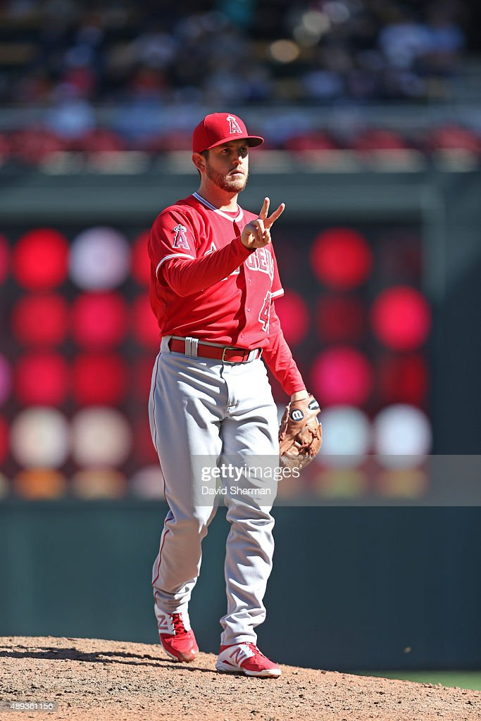 Cory Rasmus #46 of the Los Angeles Angels of Anaheim checks the pitching signals when coming into the game in relief against the Minnesota Twins at Target Field on September 20, 2015 in Minneapolis, Minnesota. The Twins defeated the Angels 8-1.