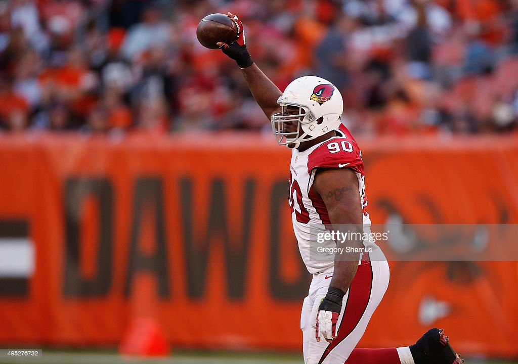 Cory Redding #90 of the Arizona Cardinals celebrates a fourth quarter fumble recovery while playing the Cleveland Browns at FirstEnergy Stadium on November 1, 2015 in Cleveland, Ohio. Arizona won the game 34-20.